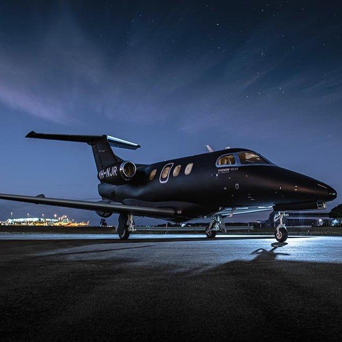 Embraer Phenom 100 Matte Black Private Jet Charter